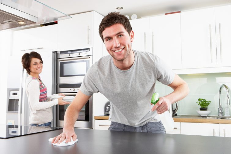 bigstock-Young-Couple-Cleaning-Cleaning-27383075