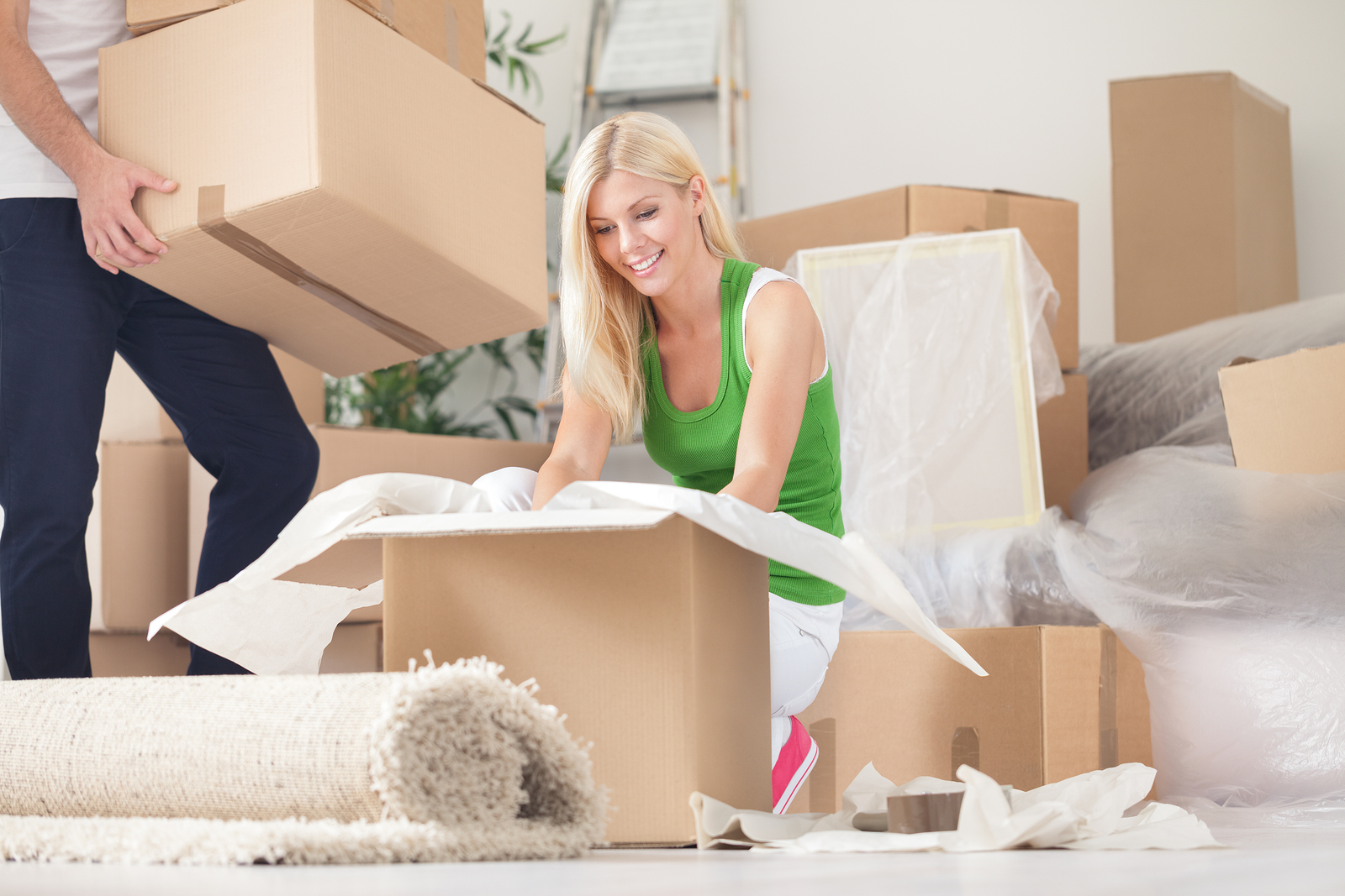 bigstock-Happy-young-woman-unpacking-bo-50952884 (2) (1)